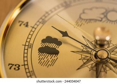 Gold Barometer indicating atmospheric pressure reduction