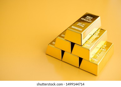 Gold bars or bullion stack on yellow background. Financial, global world economic or gold trading in commodity market concept.