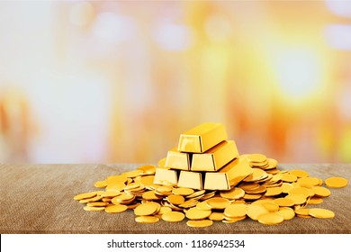 Gold bars and coins on background
