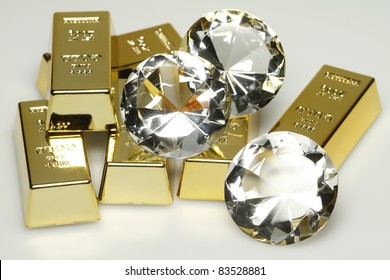 Gold bars and diamonds are together on the picture.