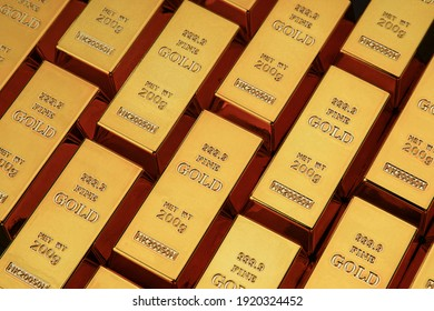 Gold bars next to each other on a black background. Shiny precious metal for investment or as a reserve. Place for text.