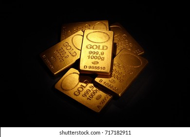 Gold Bars on black background, business concept