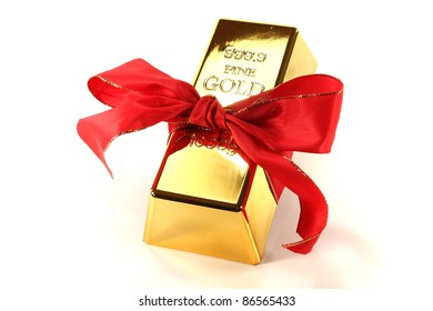 Gold bars with red bow on a white background