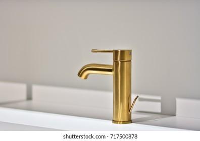 Gold bathroom faucet. Modern bathroom faucet