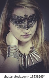 Gold, Beautiful blonde with silver jewelry and mask