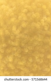 Gold beautiful bokeh background with copy space. Wallpaper, card design, and holiday texture.