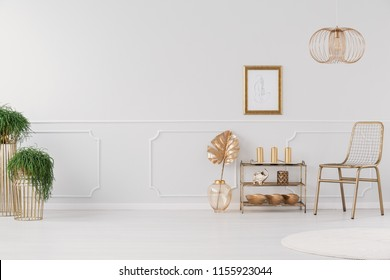 Gold bedroom on the light grey wall