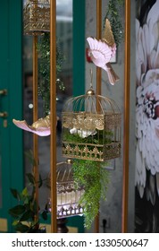 Gold birdcage decoration. Flower in birdcage