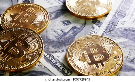 Gold Bit Coin BTC coins on bills of 100 dollars. Worldwide virtual internet cryptocurrency and digital payment system. Digital coin money crypto currency on bitcoin farm in digital cyberspace