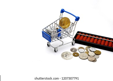 Gold Bitcion cion and gift in shopping cart , global money coin , and abacus on the floor.