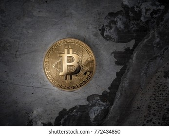 Gold bitcoin BTC coin on metal background, macro closeup.
