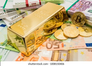 Gold Bitcoin BTC coins  with bills of euro banknotes and gold bullion