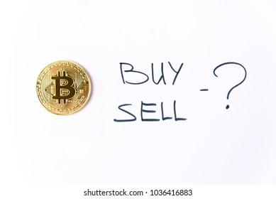 Gold bitcoin coin with inscription buy or sell on a white background isolated. Cryptocurrency business concept. Exchange bitcoin cash for a dollar. Free copyspace.