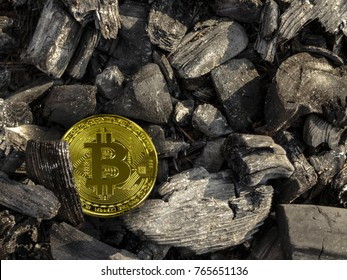 Gold bitcoin coin lies on coal. Mining bitcoins. Energy for mining cryptocurrency.