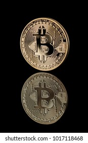 Gold Bitcoin Coin on black background.