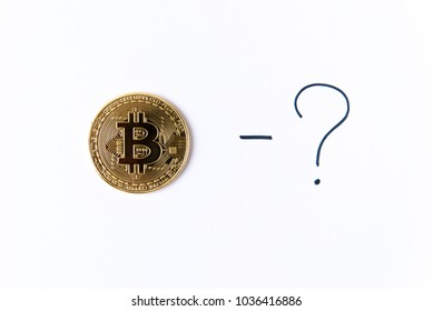 Gold bitcoin coin with question mark on a white background isolated. Cryptocurrency business concept. Exchange bitcoin cash for a dollar. Free copyspace.