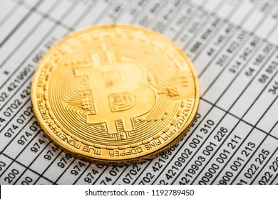Gold bitcoin cryptocurrency coin on numbers