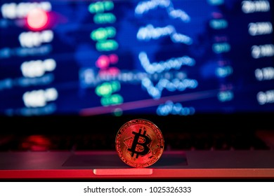 Gold bitcoin cryptocurrency with a latop computer