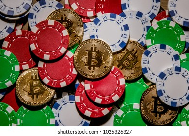 Gold bitcoin cryptocurrency with poker chips