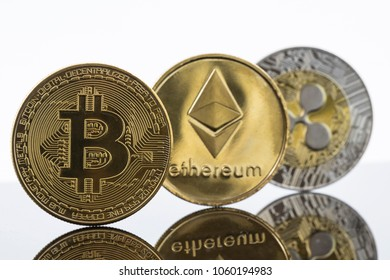Gold Bitcoin, Etherium and Ripple Token Coins