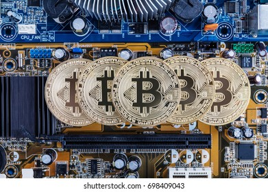 Gold bitcoin with microcircuits on a blue background. The concept of cryptocurrency.