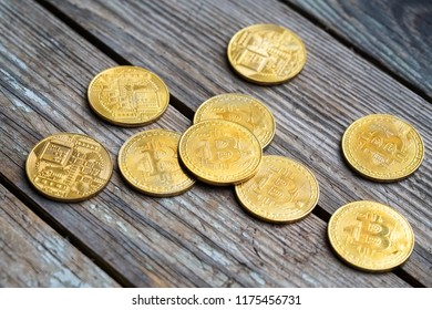 Gold Bitcoin money on wooden table. Electronic crypto currency. Business concept.