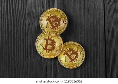 Gold Bitcoin money on wooden table. Electronic crypto currency