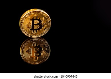Gold Bitcoin on background of black isolate.