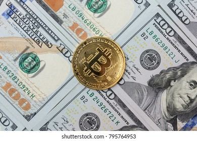 Gold bitcoin on the banknotes of dollar.