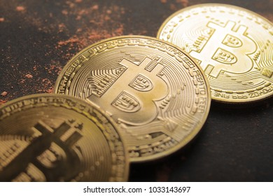 Gold bitcoin on black background. Crypto-currency concept