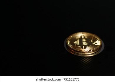 Gold bitcoin on black background