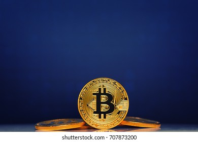 Gold Bitcoin on the blue background. Concept mining