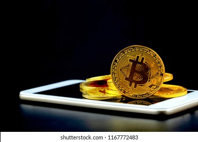 Gold bitcoin on tablet computer isolated on black background, coin money currency virtual digital exchange cash with crypto, technology finance trade, commercial business concept.
