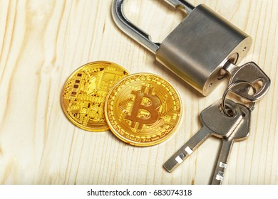 Gold bitcoin and padlock