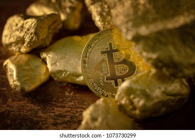 Gold bitcoin physical and Gold nugget grains. Concept mining cryptography.