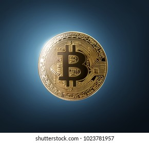 Gold bitcoin physical on blue background