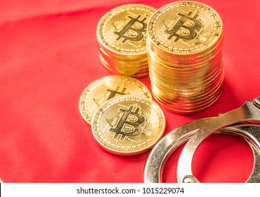 Gold bitcoin replica with handcuffs over Japan flag. Conceptual image.