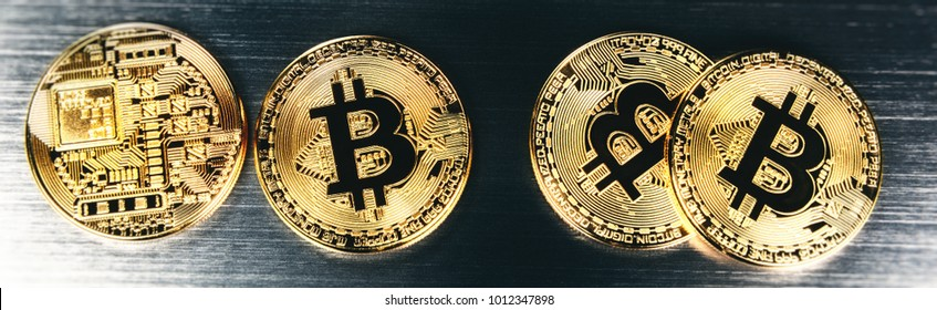 Gold bitcoins closeup. Virtual crypto currency and finance concept. Copyspace