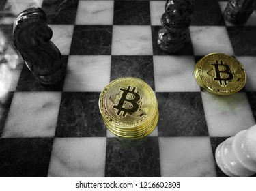 Gold Bitcoins stacked on a chess board