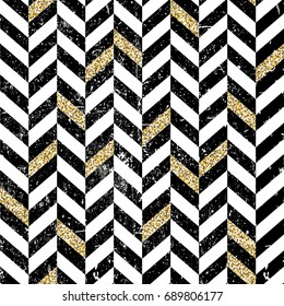 Gold and black chevron pattern. Vintage seamless chevron pattern. Grunge and textured