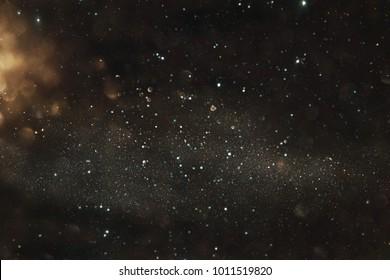 Gold and black glitter lights background. defocused