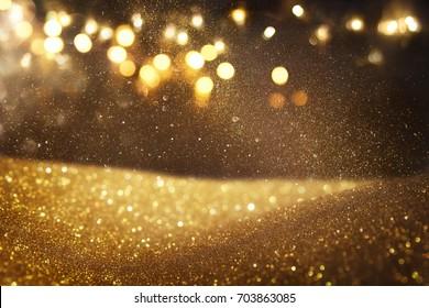 Gold and black glitter vintage lights background. defocused.