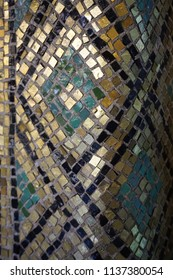 Gold, black, and green mosaic geometric design detail