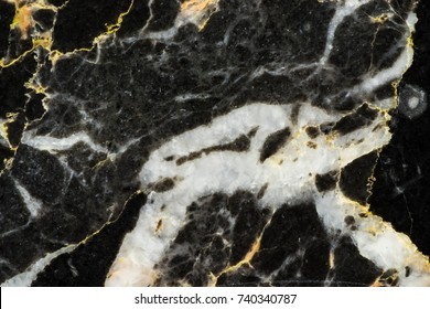 gold and black marble pattern texture detail structure with bore line from natural stone