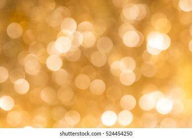 Gold blur abstract bokeh light backgound form streamer