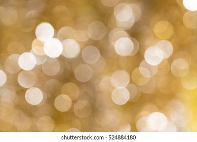 Gold blurred abstract bokeh light backgound form streamer