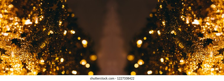 Gold blurry defocused bokeh Christmas tree on two sides - with copy space used for banner