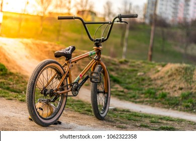 Gold bmx bike. Bike on sun set.