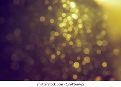Gold bokeh blur defocus in black use for backgeound