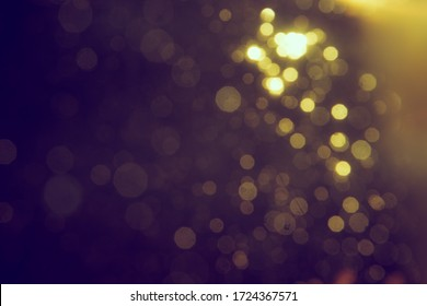 Gold bokeh blur defocus in black use for backgeound